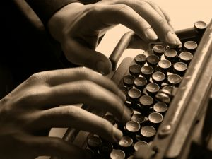 old-typewriter-and-typist-966154-m